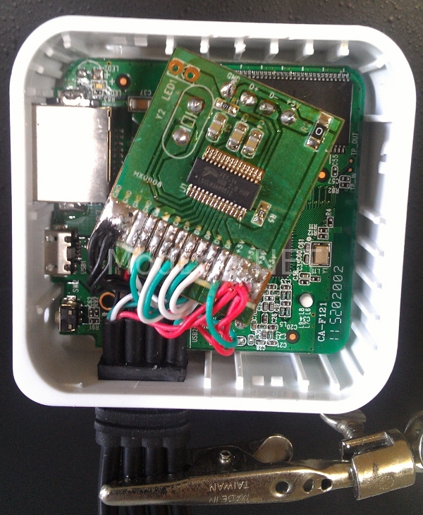 Insert PCB's back into the case and resolder leads